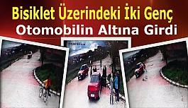 Bisiklet Üzerindeki İki Genç, Otomobilin Altına Girdi